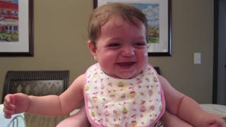 Adorable baby laughs hysterically at her sister