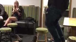 Guy blue sweater tries jumping on seats and falls - Video