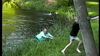 Fully Clothed Grandpa Crashes Into Lake While On A Rope Swing - Video