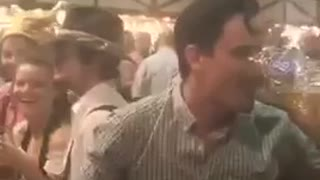 Guy white shirt balancing beer and friend drinking it - Video