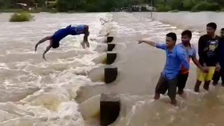 When river overloaded with water boys came to enjoy in river  - Video