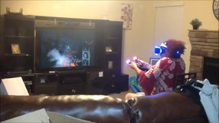 Gaming Grandma Completely Freaks Out When VR Zombies Appear On Screen  - Video