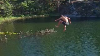 Guy rope swing lets go late falls into water on side - Video
