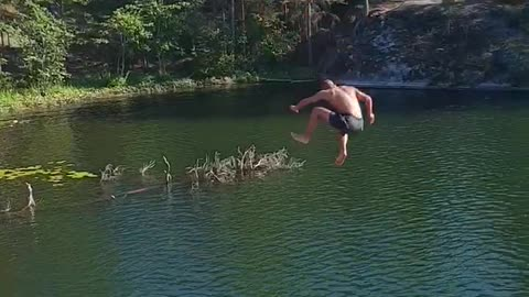 Guy rope swing lets go late falls into water on side