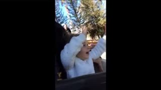 Little girl's very first roller coaster ride - Video