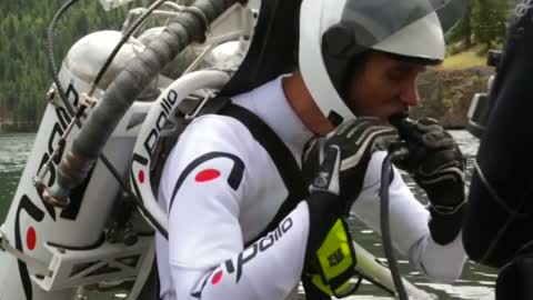 Jet pack pilot performs amazing water stunt