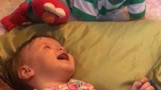 Big brother preciously makes baby sister laugh