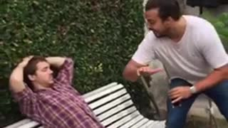 Guy slaps friend