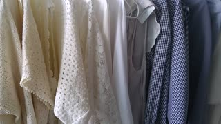 Going through clothing rack in beautiful colours