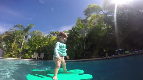 Cute little girl jumping into pool and floating!