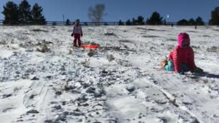 Mom on sled with little girl in pink gets dropped off in snow - Video