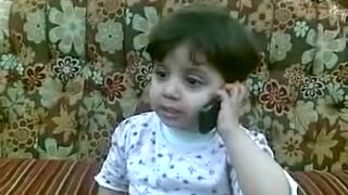 small baby talking on telefone amazing  - Video