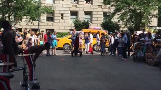 NYC street performer flips  - Video