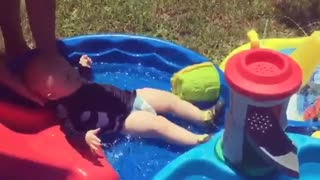 Collab copyright protection - baby slides down waterslide - Video