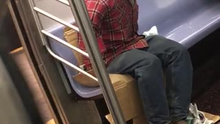 Headless red shirt guy rides subway someone takes picture of him