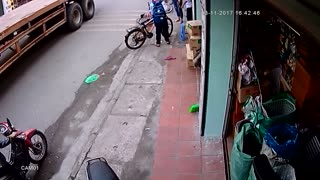 Truck Narrowly Avoids Running Over Kid On Bike - Video