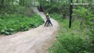 Girl in yellow green helmet dirt bike crash and fall - Video
