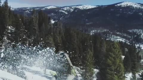 Skier backflips off ramp and lands on the front of skis