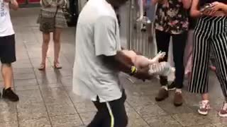 Man dancing with toy doll in subway station - Video