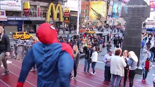 Man dressed as spiderman walks around times square - Video