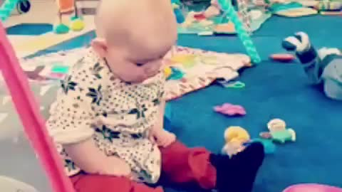 Sleepy baby literally falls over while sitting up