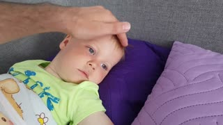 Daddy Puts Baby to Sleep with Gentle Touch
