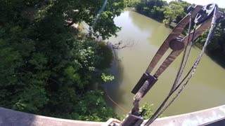 Incredible Bow Fishing Shot From a Bridge - Video