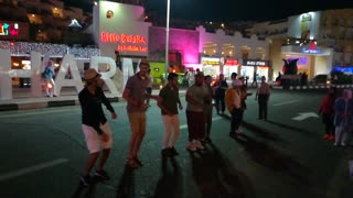Tourists Joins Performers In Street Dance