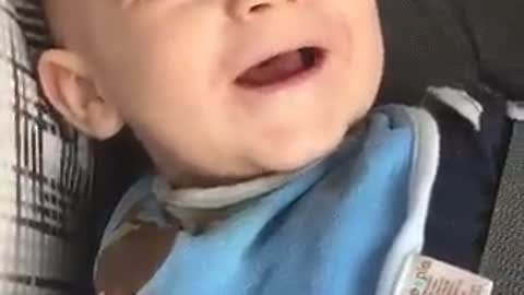This baby's laughter is extremely contagious!