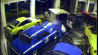 Thieves steal $180,000 car off showroom floor - Video