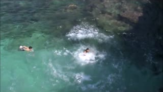 Backflip off cliff goes wrong - Video