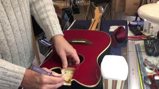 Fendercoustic - awful guitar - has everything wrong with it.