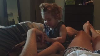 Jealous toddler competes with mommy for affection - Video