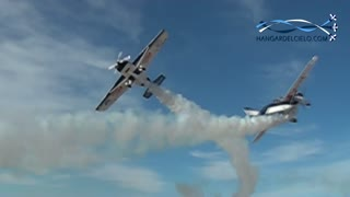 Two stunt pilots perform incredibly close flyby
