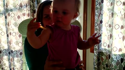 Baby laughs hysterically at puppy eating french fries