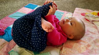 Baby tries to eat her own toe - Video