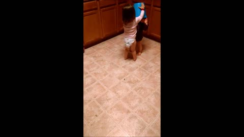 Cute toddler stumbles around with bucket on head