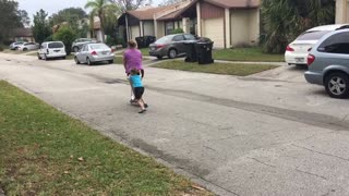 Mom Faceplants While Trying to Ride Razer Scooter - Video