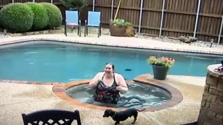 Surprise Splash While Helping a Doggy Into the Pool