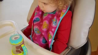 2-year old verbally expresses a range of emotions in her high chair - Video