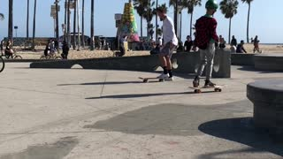 Kid in white shirt near beach skateboard - Video