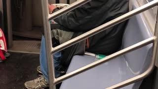 Old guy with backwards hat smoking on subway - Video