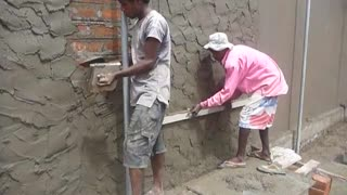 Sri Lanka,ශ්‍රී ලංකා,Ceylon,Plastering a Brick wall (Mortar)  - Video