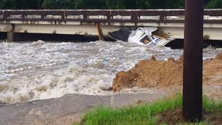Camper Destroyed by Flooded Waters - Video