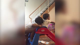 Older Sister Pushes Brother Down the Slide - Video