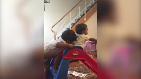 Older Sister Pushes Brother Down the Slide
