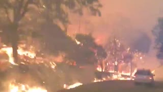 Terrifying video shows California deputy driving through flames after evacuating residents