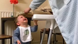 Baby Delighted by Recycling