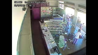 Two Cyclists Crash Through Drugstore - Video