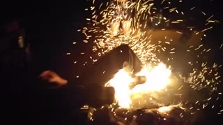 Dancing kid falls into campfire - Video